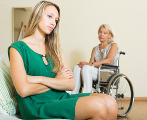 Upset woman and handicapped