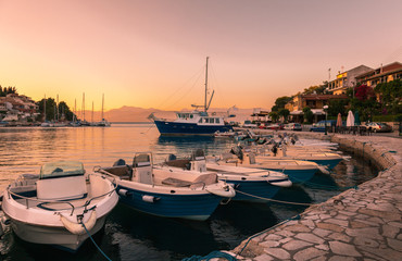 Sea bay with boats at sunset