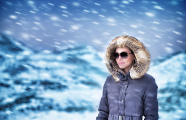Fashion model in winter mountains