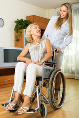nurse and disabled woman on chair