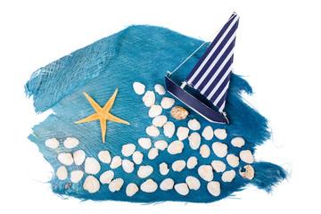 Muscheln, Boot und Seestern