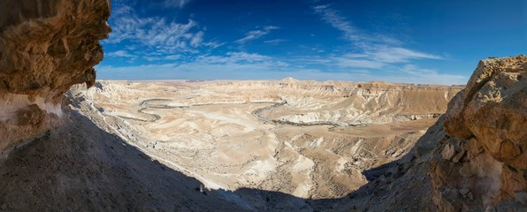 Desert cliffs and river panorama.