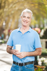 American Senior Man with Coffee Drink at Park