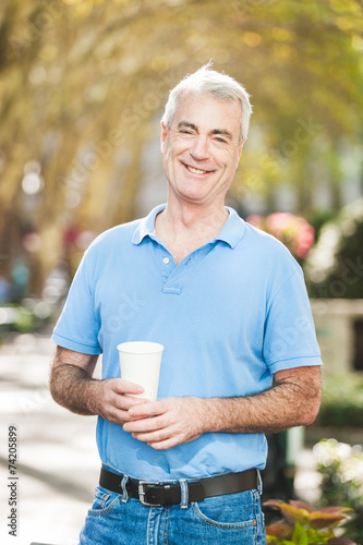 canvas print picture American Senior Man with Coffee Drink at Park