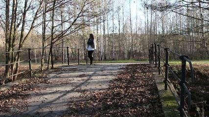 girl walking in autumn park