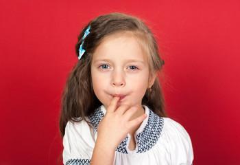 girl eating sweet food from finger