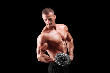 Male bodybuilder lifting a metal weight