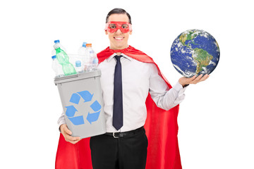 Superhero holding recycle bin and the earth