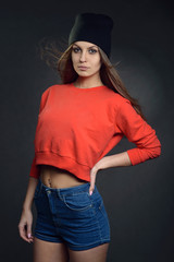 Beautiful young woman in hip hop style with hat