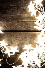 ..Christmas rustic background with lights, snowflakes, stars and