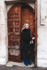 young woman opens the door of the church