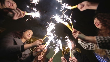 SLOW MOTION: Friends with sparklers dancing