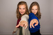 two cool kids pointing