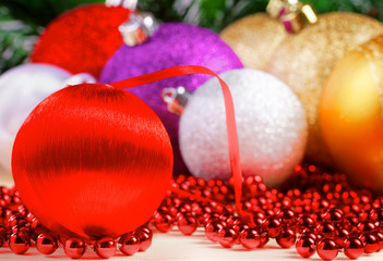Variety of christmas balls on red beads decoration