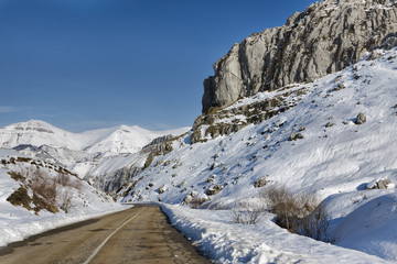 First snow. Mountain road.