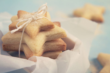 Close up of star shaped cookie biscuits in a box horizontal