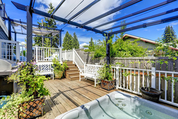 Walkout deck  with jacuzzi and pergola