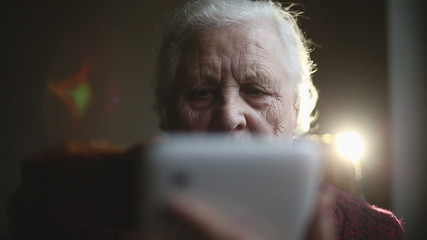 Old woman and electronic tablet. Close up