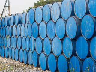 oil drums stacked together in a yard