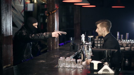 The robber breaks into a bar and takes the money