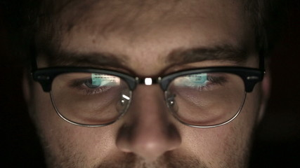 Portrait of a young man with glasses who works at night.