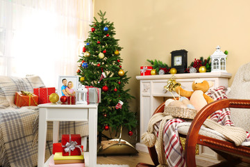 Beautiful Christmas interior with decorative fireplace and fir