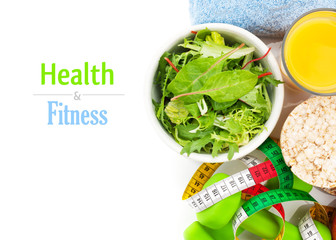 Dumbells, tape measure, healthy food and towels. Fitness and hea