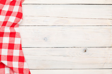 Red towel over wooden kitchen table
