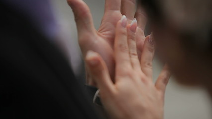 Man and woman caressing each other's hands