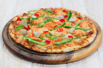 Delicius pizza on wood