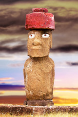 Standing moai with red stone hat and eyes in Easter Island, Chil