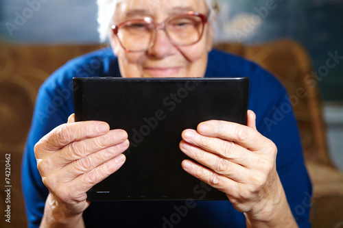 Elderly woman with tablet computer - 74220462