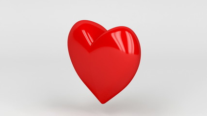 Shiny red heart spin on gray background