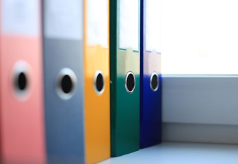 The image of colorful file folders
