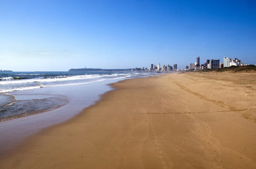 Empty Beach on Golden Mile with Durban City Skyline