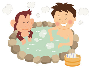 温泉で猿と入浴する男性