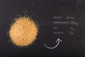 Brown sugar on written nutritive values on chalkboard