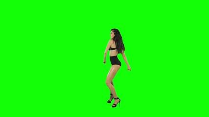 Go-go dancer girl isolated on green screen. Slow motion