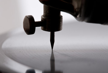 gramophone needle playing record