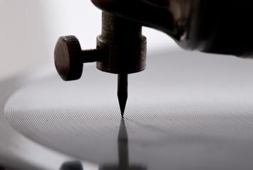 gramophone needle playing record