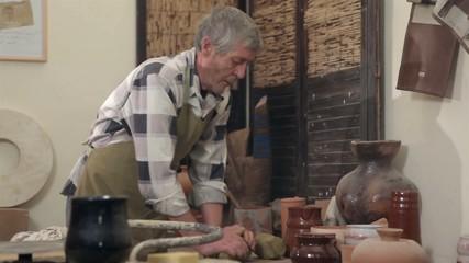 Master preparing his molding his clay