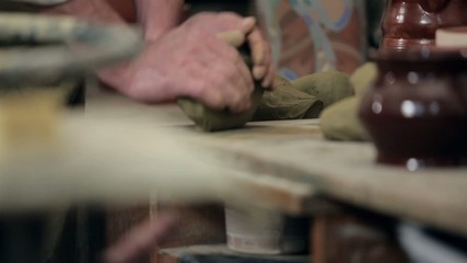 Preparing for molding a piece of clay