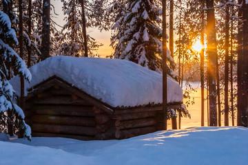 Wooden barn in sunset