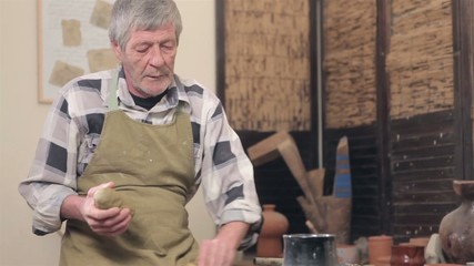 Men preparing his pot in studio