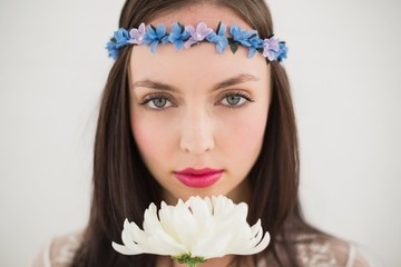 Pretty hippie smelling a flower