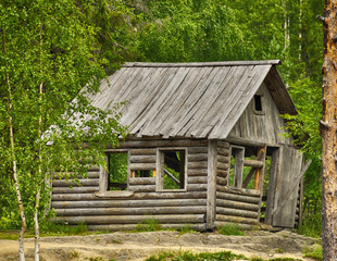 Old typical Russian wooden house in the forest