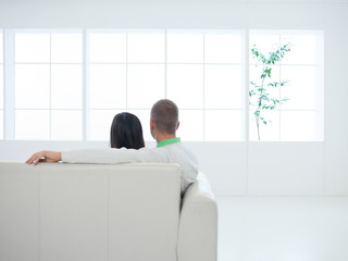 couple enjoying the view sitting on couch