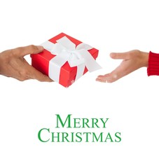 Composite image of couple passing a wrapped gift
