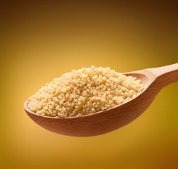 Couscous (cooking) in a wooden spoon