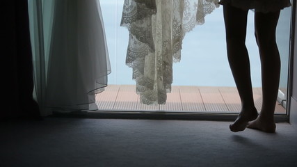 The bride wears a wedding dress in the morning